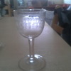 Antique wine glass with few air bubbles unevenly cut