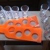 Orange shot glass holders + 8 shot glasses.