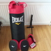 Punch bag, gloves, pads and exercise bike