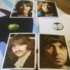 THE BEATLES 1968 WHITE ALBUM WITH FOUR 11 x 8 INCH  PHOTOGRAPHS OF THE BEATLES.NUMBER 0116251.
