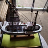 a very nice model orniment fishing boat on a stand