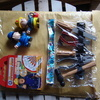 a mix of toy figures, firman sam activity book & plastic tools