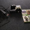 Black Xbox 360 with games