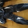 Motorbike leathers 2 piece but can be zipped to one piece..