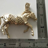Solid gold horse pendent and chain