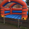 Tiger themed adult bouncy castle