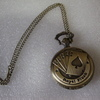 a very nice pocket watch on a chain