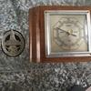 German old clock plus a badge