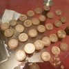 100s of £2 and 50p the rarer ones