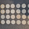 A collection of 50ps, 10p and £2