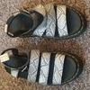 Dr Martens sandals snake pattern