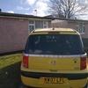 yellow Peugeot 1007 desiel