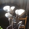 Golf clubs and donney bag