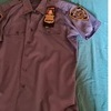 nypd shirt , badges , and hat