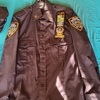 nypd shirt,  hat , and badges