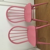 Two wooden up cycled pink chairs